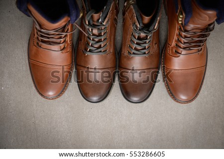 men's shoes.men fashion still life.boots-gray background