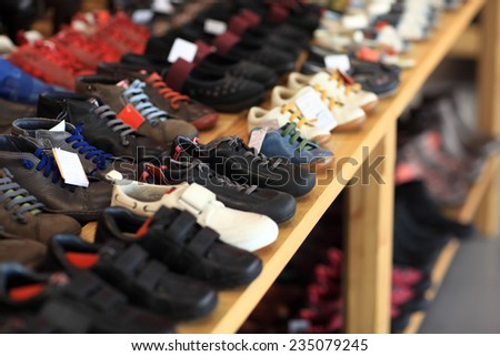 Men's shoes on the wooden shelf in the market