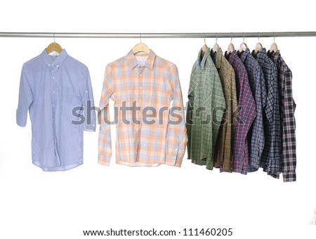 Men's sleeved plaid cotton on a wooden hanger - stock photo