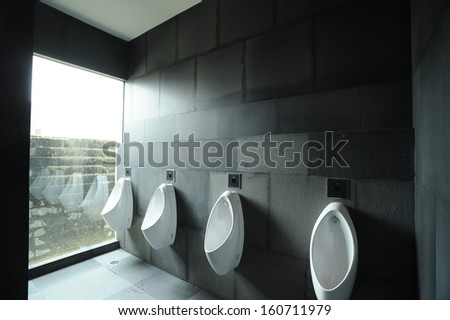 Men's urinals. - stock photo