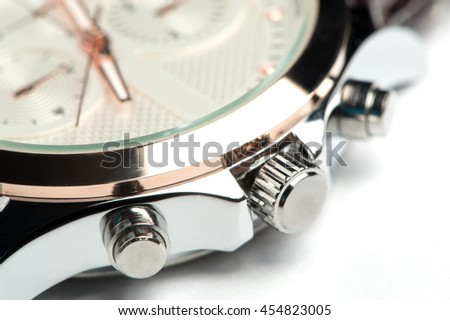 Men's watch with leather strap and white dial, isolated on a white background