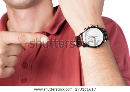 Men's watch with leather strap and white dial, on the hand - stock photo