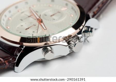 Men's watch with leather strap and white dial, white background, detail, close-up, shallow depth of field - stock photo