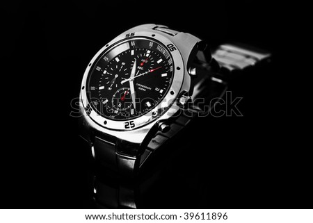 Men's wrist watch isolated against black - stock photo