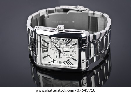 Men's wrist watch on black background.  Studio shoot. - stock photo