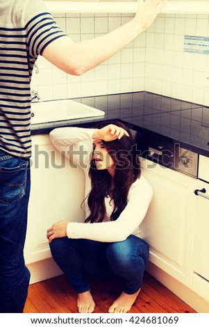 Men shouting on his girlfriend in the kitchen. - stock photo