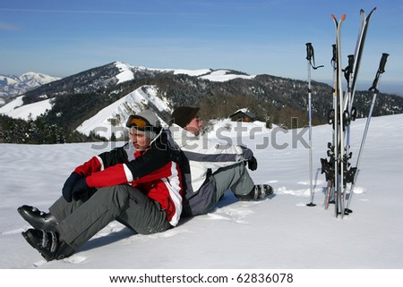 Men sitting in snow - stock photo