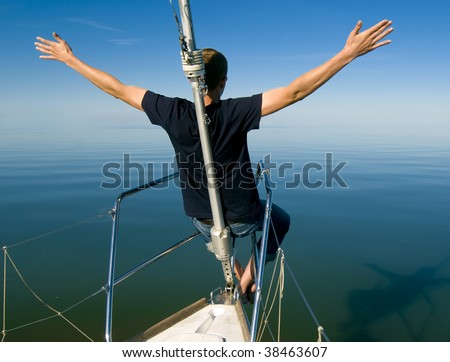 Men sitting on the yacht front - stock photo