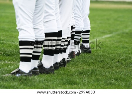 Men standing in line. League referee concept - stock photo