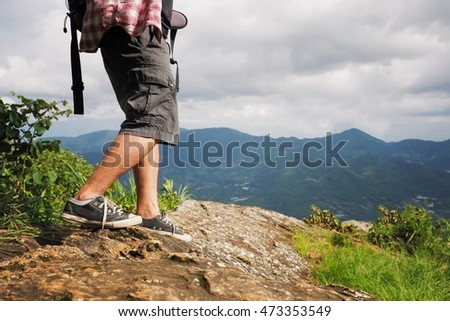 Men stay or walk on mountain and beautiful view.