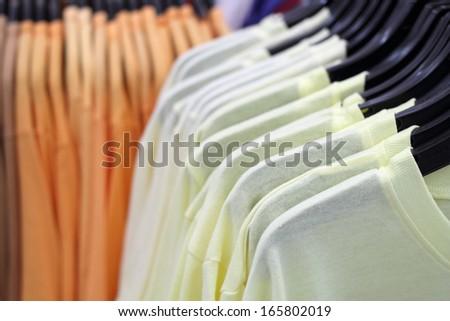 men T-shirts on hanger - stock photo