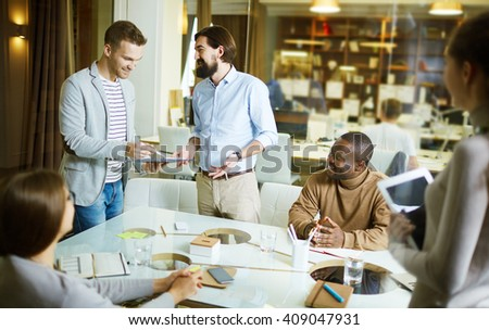 Men talking during meeting in office - stock photo