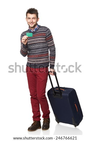 Men tourist. Young man standing with suitcase and holding a card of the bank credit, isolated on white background - stock photo