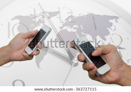 Men using blank screen mobile smart phone with clock and world map background, world wide connection concept. - stock photo