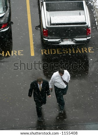 Men walking in parking lot - stock photo