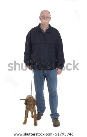 Men walking with dog isolated on white - stock photo