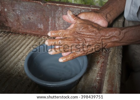 Men washing his hands in Guatemala - stock photo