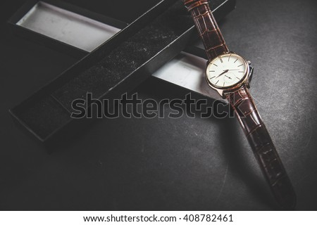 men watch in a gift box - stock photo