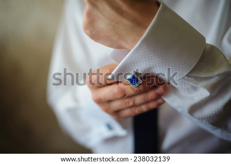 men wear cufflinks on a shirt sleeve - stock photo