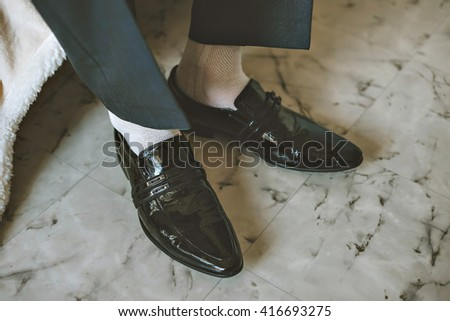 Men wearing work black boot. returning to the house. - stock photo