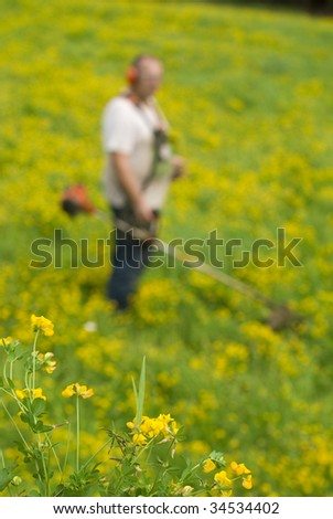 Men with a grass cutter - stock photo
