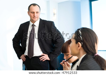 Men with girl and women with pen - stock photo