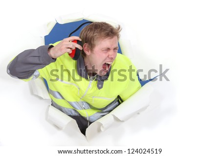 Men with helmets and unbearable noise - stock photo