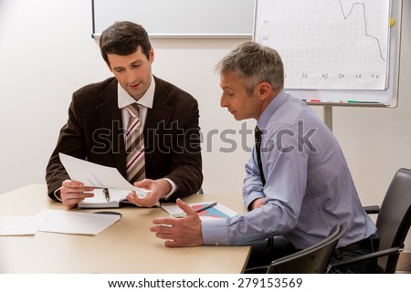 Men with interest to discuss the business plan. Managers at the meeting in the meeting room. - stock photo