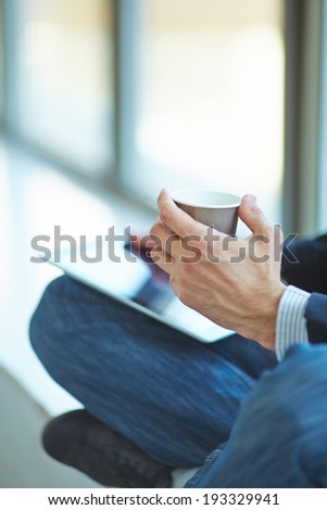 men with pc tablet and coffee