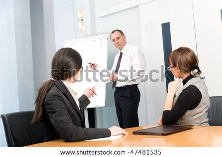 Men with pen with girl and women - stock photo