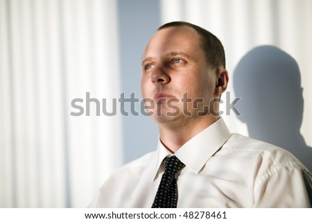 Men with short hairstyle in white shirt - stock photo