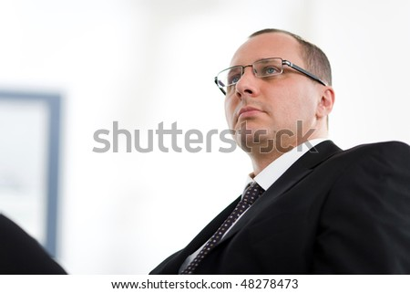 Men with tie in suit on chair