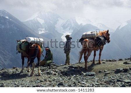 Men, woman and mountains. Altay. Russia. - stock photo