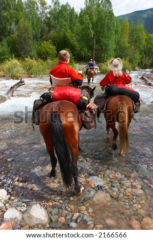 Men, women and horses. Altay. Russia. - stock photo