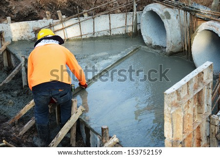 Men work on concrete sewer