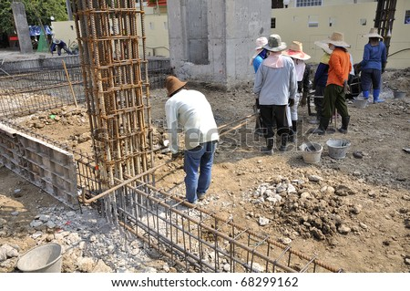 Men working at site construction. Photo Show is a template to place the concrete beam only. - stock photo
