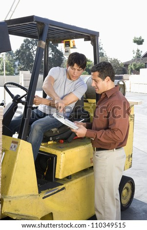 Men working in a warehouse - stock photo