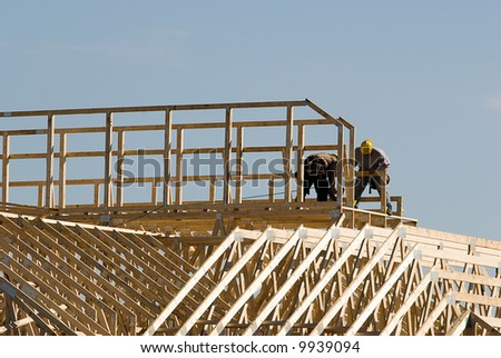 Men working on new construction - stock photo