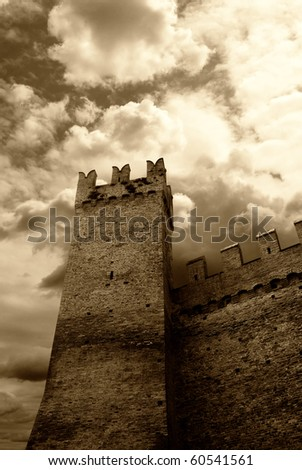 menacing sky over an ancient castle - stock photo
