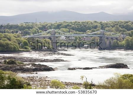 Menai bridge crossing from Wales mainland to island of Anglesey - stock photo