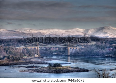 Menai Bridge in winter with Snow on the snowdonia National Park North Wales - stock photo