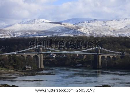Menai Suspension Bridge linking the Isle of Anglesey with North - stock photo