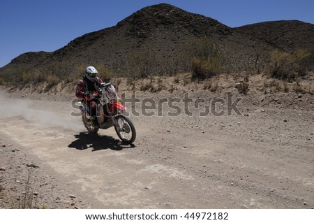 MENDOZA, ARGENTINA - JANUARY 15: A Motorcycle in the Rally DAKAR Argentina - Chile 2010. January 15, 2010 in Mendoza, Argentina - stock photo