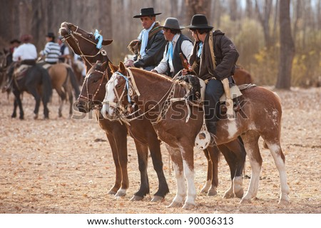 MENDOZA, ARGENTINA - MAY 25: Gauchos riding a horse in exhibitions for Argentina 200 hundreds years anniversary. May 25, 2010 in Mendoza, Argentina - stock photo