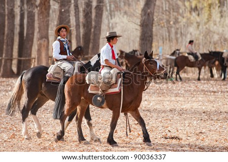 MENDOZA, ARGENTINA - MAY 25: Young Gauchos riding a horse in exhibitions for Argentina 200 hundreds years anniversary. May 25, 2010 in Mendoza, Argentina - stock photo