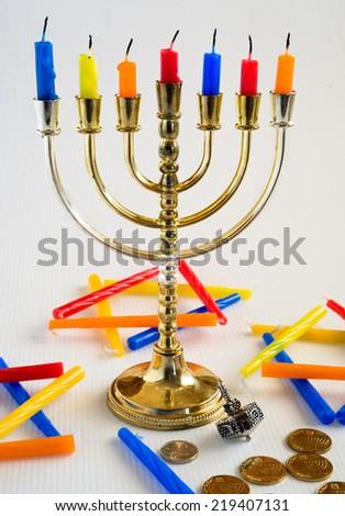 Menorah and candles for Hanukkah celebration. - stock photo
