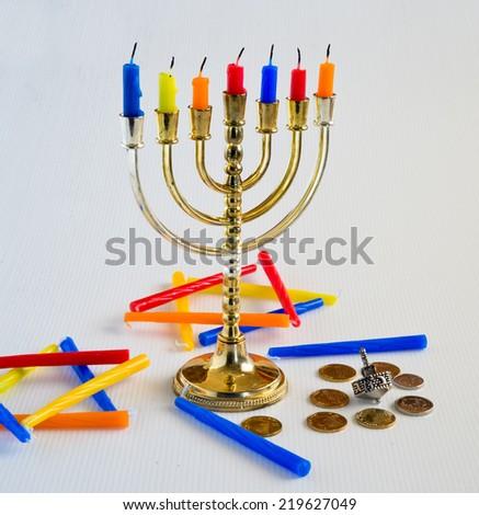 Menorah, candles and silver dreidel for Jewish Hanukkah celebration. - stock photo