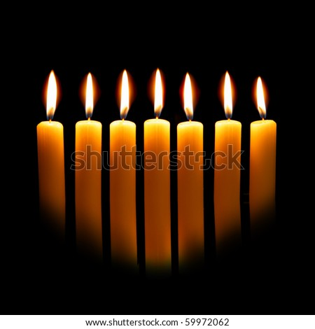 Menorah close up  over the black background - stock photo