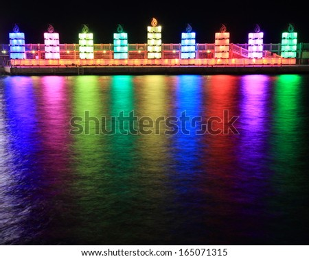 Menorah on the water for Hanukkah - stock photo