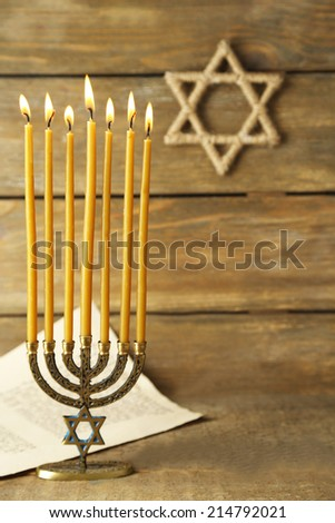 Menorah on wooden background - stock photo